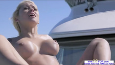 Horny Marsha May shows her sexy curve until she gets laid in open waters