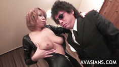 Asian Milf in black leather catsuit shows her nice tits