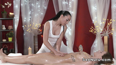 Dark haired babe gets full body massage