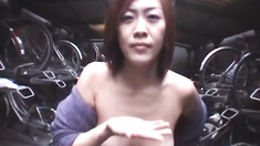 Yukari gives blowjob in garage