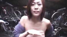 Yukari gives blowjob in garage