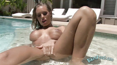 Busty Babe Plays In The Pool