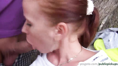 Redhead beauty Minnie Manga takes two cocks in public for cash
