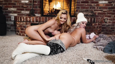 Hot lesbian oral sex beside fireplace