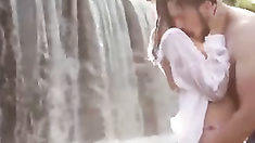 erotic games of a sexy brunette under a waterfall  - ForDreamers.com