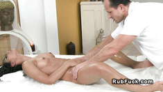 Petite tanned beauty fucks masseur