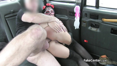 Costumed babe does anal in taxi