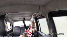 Lesbians toying in back seat in cab