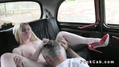 Busty blonde changing in fake taxi