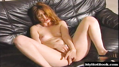 This horny redhead has really sensitive nipples. She sits on the big black