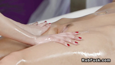 Busty brunette fingers her masseuse
