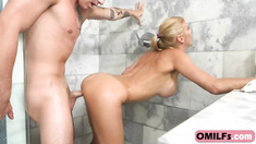 Fantastic Blonde MILF Rides Cock In The Bathroom